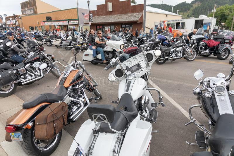 Taking a ride down Main Street in Sturgis, South Dakota, past thousands of parked motorcycles. AUGUST 5, 2018, STURGIS, SD: 500,000 bikers bring their stock photo