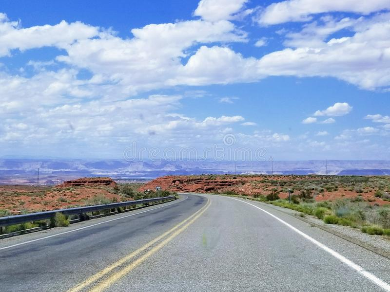Landscape with road in Arizona USA. Taking a road trip while traveling in Arizona USA. One of the most beautiful roads royalty free stock image