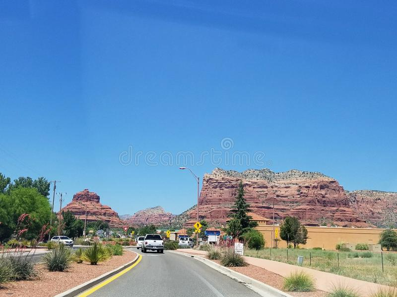 Landscape with road in Arizona USA. Taking a road trip while traveling in Arizona USA. One of the most beautiful roads stock photo