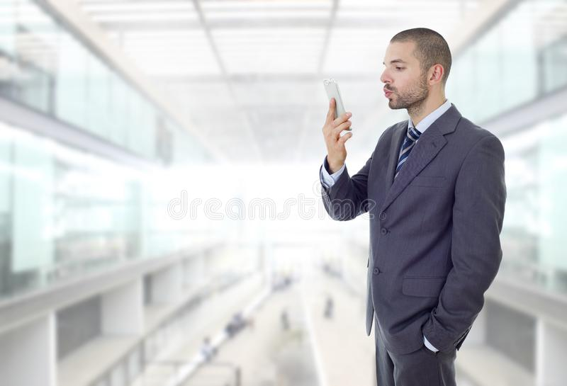 Taking selfie. Businessman in suit and tie taking selfie photo with mobile phone camera posing happy and successful at the office stock image