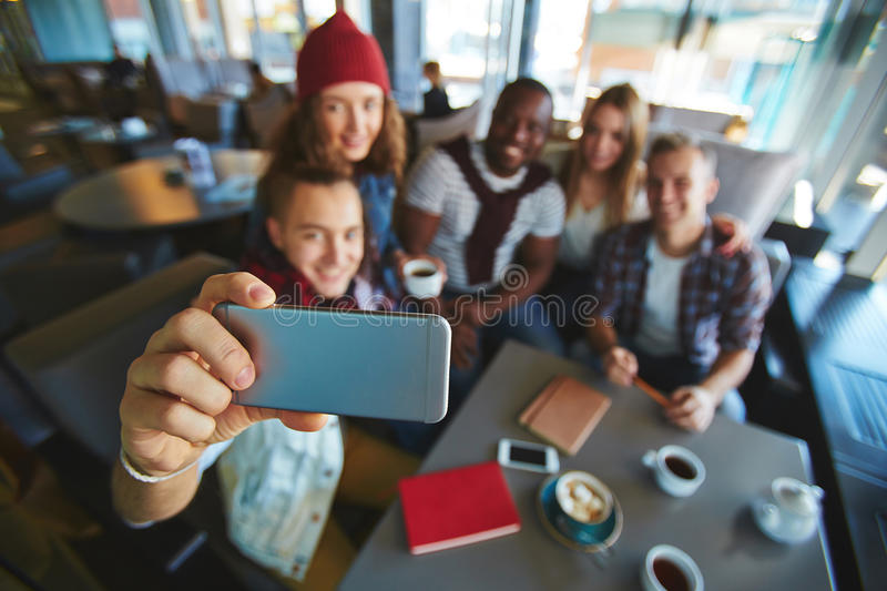Taking Selfie in Coffeehouse stock photography
