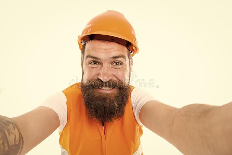 Taking selfie. Construction industry. Bearded hipster safety engineer. Engineering career concept. Architect builder stock photo