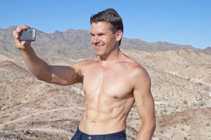 Taking a selfie in the desert stock photos
