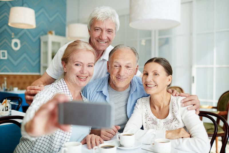 Taking Selfie with Friends stock image