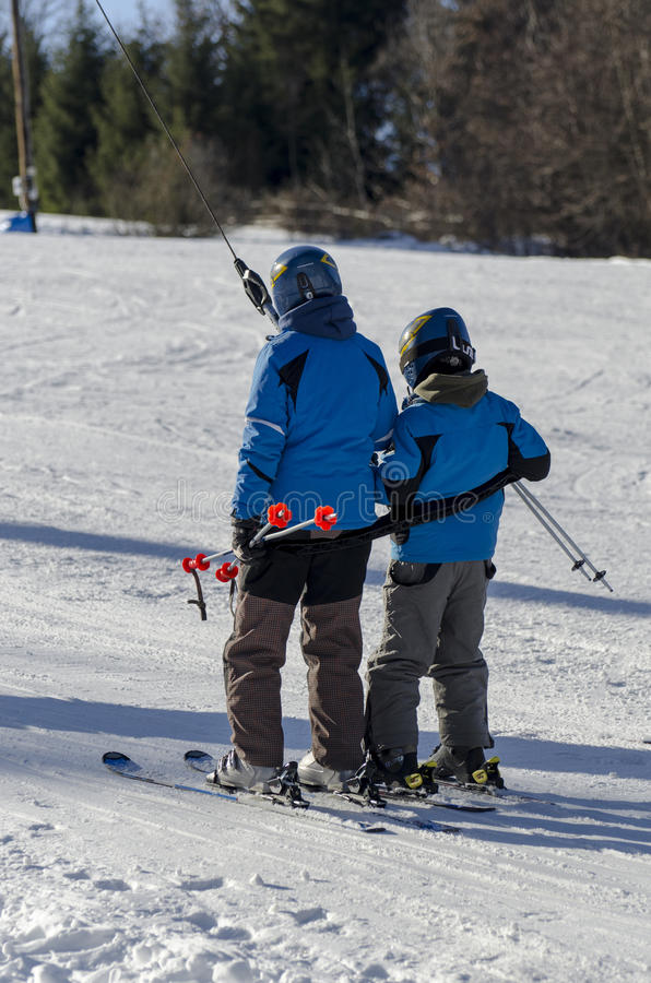 Taking the ski lift royalty free stock photography