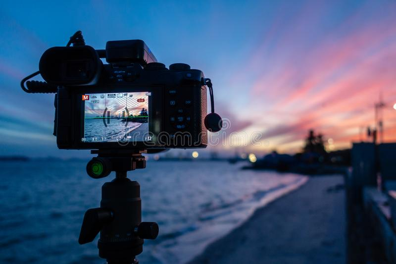 Taking sunrise photo at the beach beside Padang Kota Lama, George Town, Penang, Malaysia. Camera capturing beautiful colorful sky sunrise photo at the beach royalty free stock images