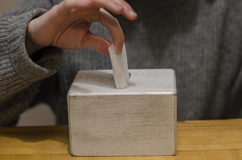Taking a napkin out of the box stock image