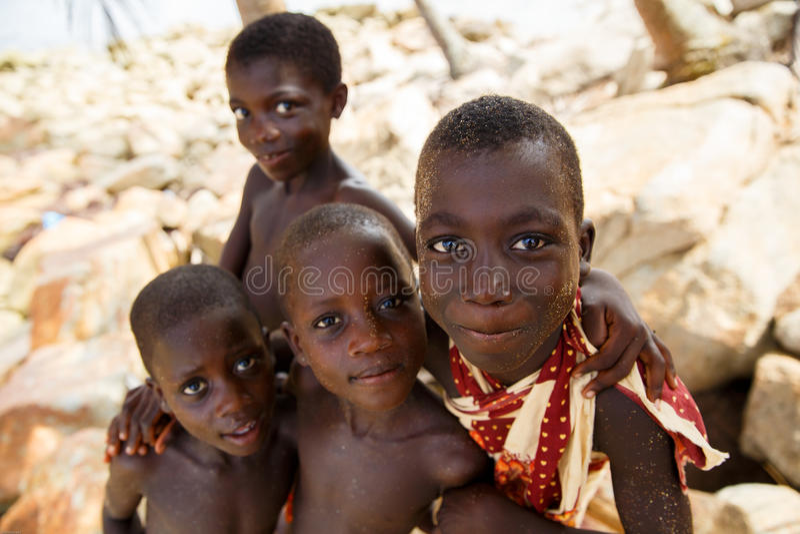 TAKORADI, GHANA � MARCH 22: Unidentified african boys from nativ. E fishing village greeting to tourists on March 22, 2014 in Takoradi, Ghana. Takoradi has royalty free stock image