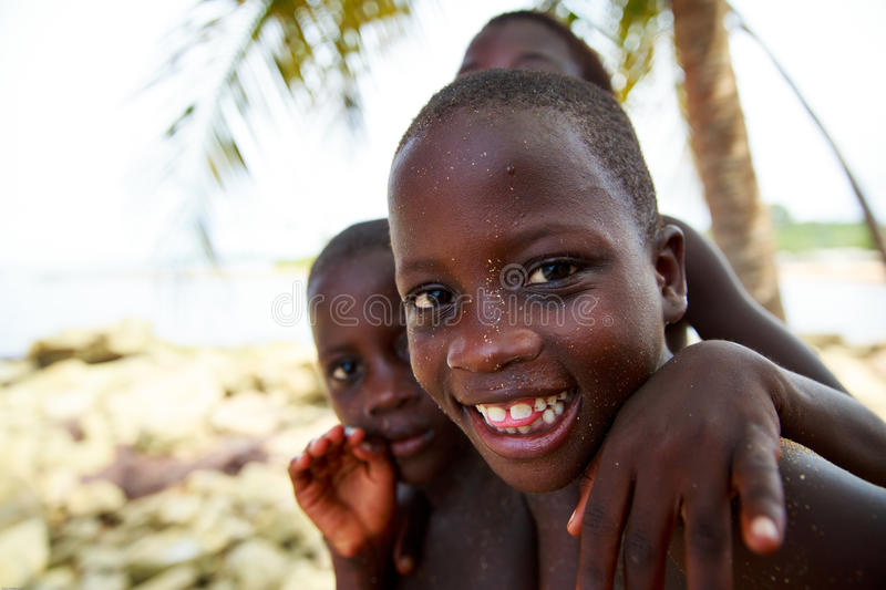 TAKORADI, GHANA � MARCH 22: Unidentified african boys from nativ. E fishing village greeting to tourists on March 22, 2014 in Takoradi, Ghana. Takoradi has royalty free stock photography