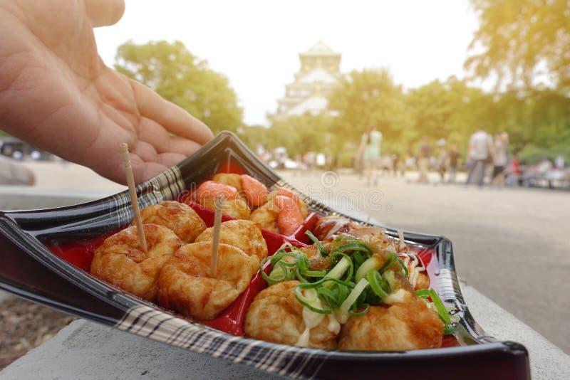 Takoyaki four styles are famous of Osaka. Traditional Takoyaki four styles,Local desserts are famous throughout the world of Osaka. Grill flour wrap squid in royalty free stock photo