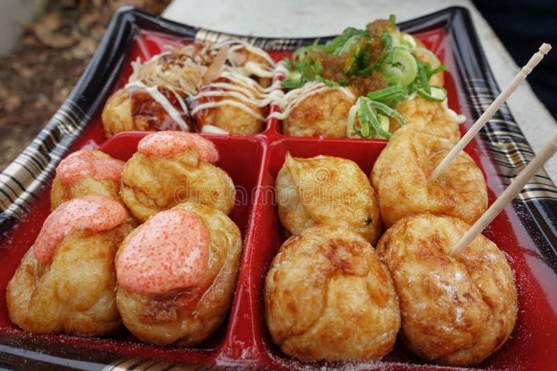 Takoyaki four styles are famous of Osaka. Traditional Takoyaki four styles,Local desserts are famous throughout the world of Osaka. Grill flour wrap squid in stock photos