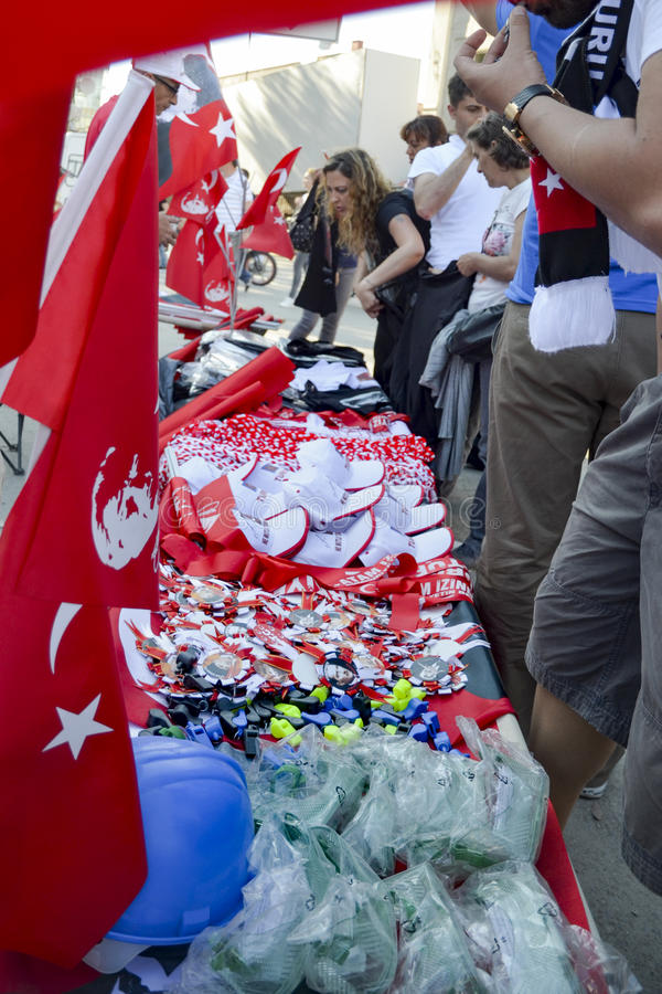Taksim Gezi Park protests and Events.Products sold in the protest area, Helmet, Whistle, badges, flags, hats, gas masks. stock image