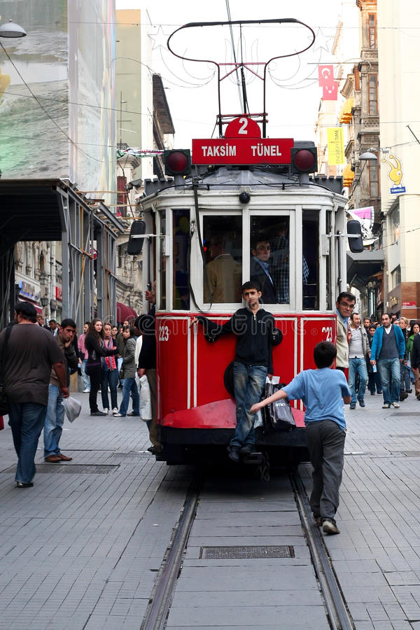 Taksim Square Tramway. Children run with the tram on Istiklal street October 14, 2008 in Istanbul stock images