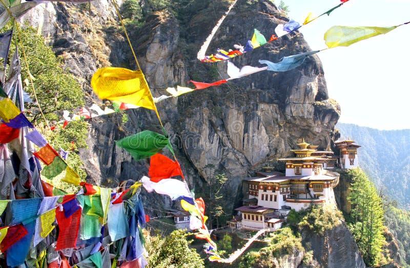 Taktshang Goemba or Tiger`s nest monastery with colorful Tibetan. Prayer flags, Paro, Bhutan royalty free stock photo