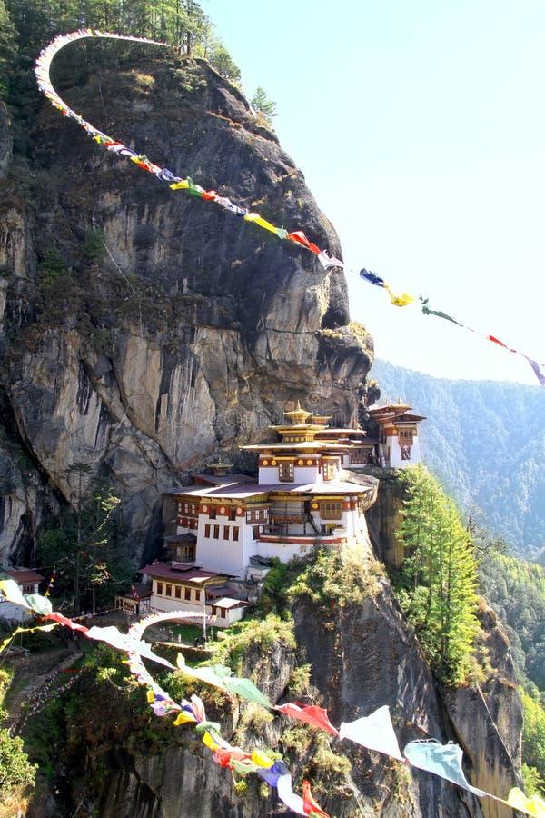 Taktshang Goemba or Tiger`s nest monastery with colorful Tibetan. Prayer flags, Paro, Bhutan stock photo