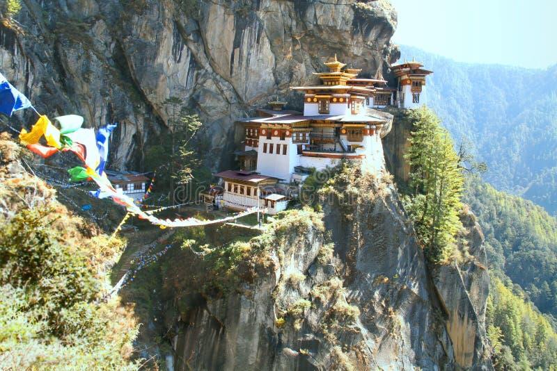Taktshang Goemba or Tiger`s nest monastery with colorful Tibetan. Prayer flags, Paro, Bhutan royalty free stock photography