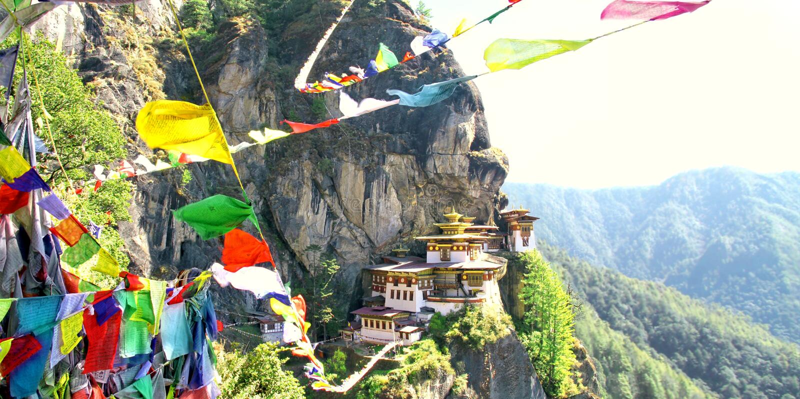 Taktshang Goemba or Tiger`s nest monastery with prayer flags. Taktshang Goemba or Tiger`s nest monastery with colorful Tibetan prayer flags, Paro, Bhutan royalty free stock photo