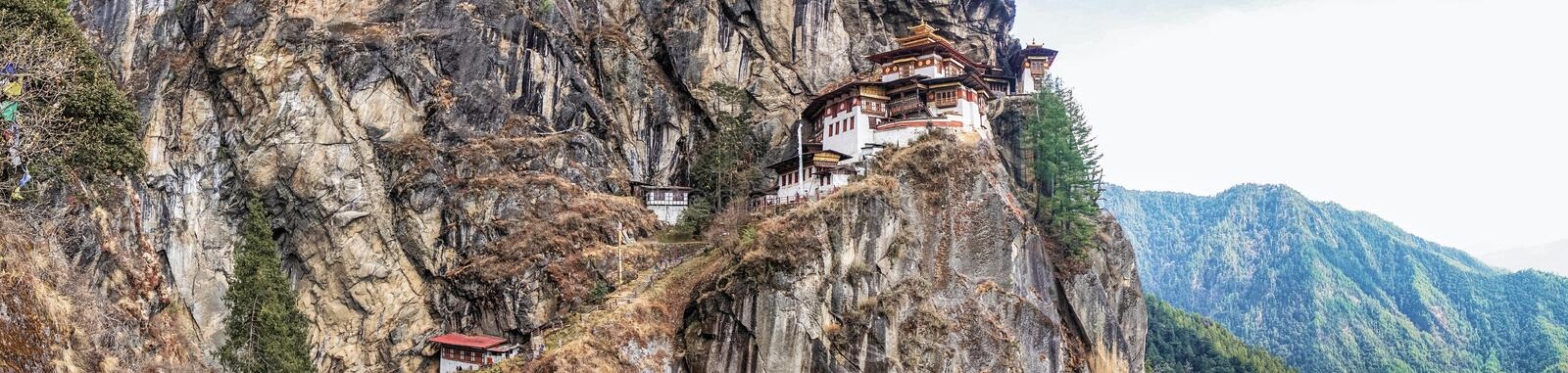 Taktshang Goemba or Tiger's nest Temple on mountain in Panorama view. stock photography
