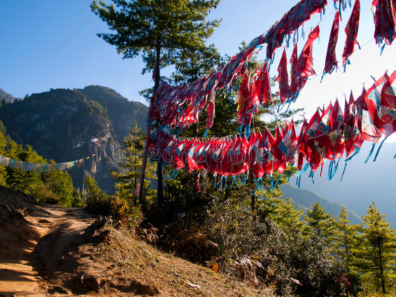 Taktshang monastery in Paro (Bhutan). View of the Taktshang monastery in Paro (Bhutan) with prayer flags (focus on monastery stock images