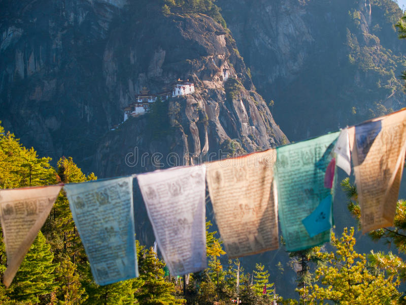 Taktshang monastery in Paro (Bhutan). View of the Taktshang monastery in Paro (Bhutan) with prayer flags (focus on monastery stock photography