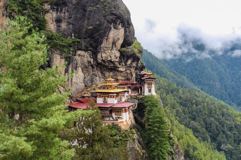 Taktshang Monastery (Tiger's Nest), Paro Valley, Paro District, Bhutan. Monastery hugging the side of a rocky cliff 3,000 feet above the Paro valley in Bhutan royalty free stock image