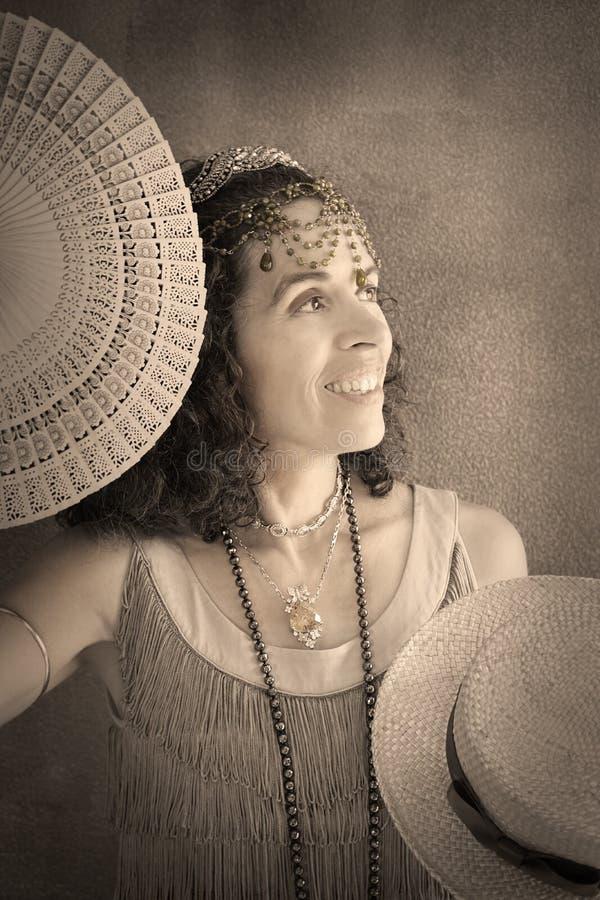20-tal för kvinnaståendeklaff royaltyfria foton