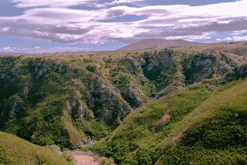 Tal, Hügel, Ebenen und Himmel lizenzfreie stockbilder