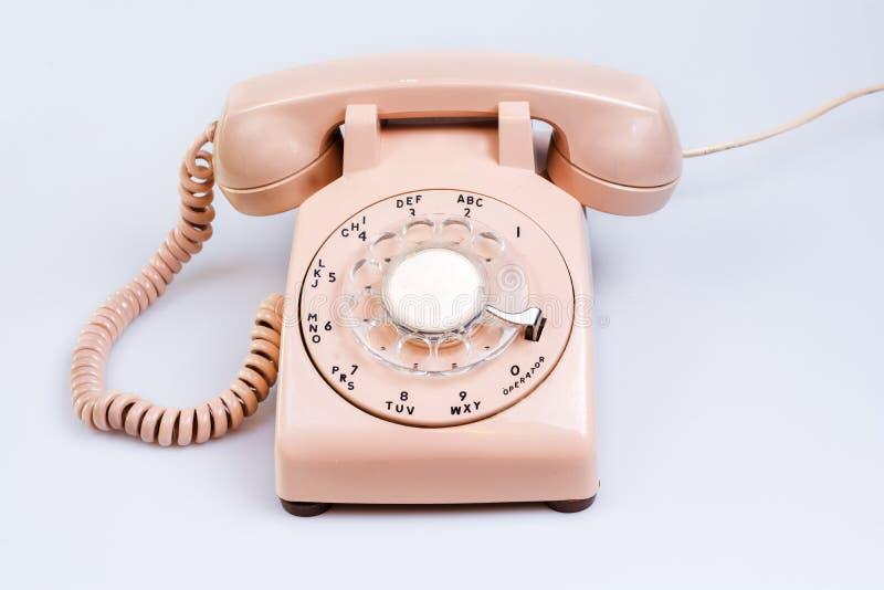 60-tal lagar mat med grädde den roterande telefonen arkivbild