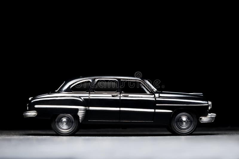 50-tal svärtar leksakmodellbilen fotografering för bildbyråer