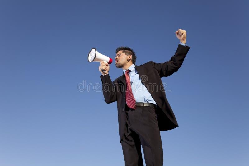 tala för affärsmanmegafon arkivfoto