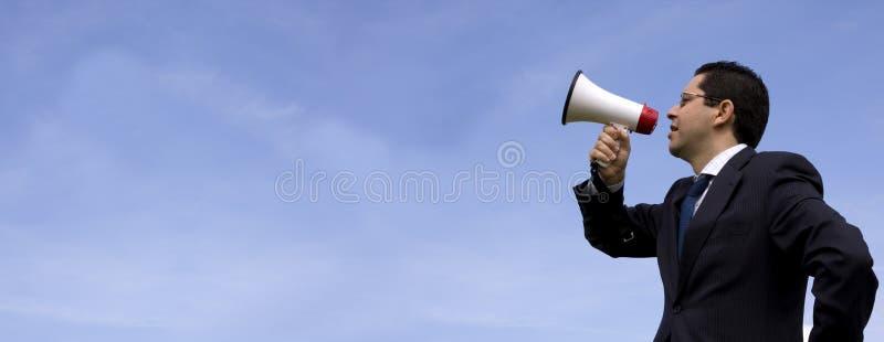 tala för affärsmanmegafon arkivbild