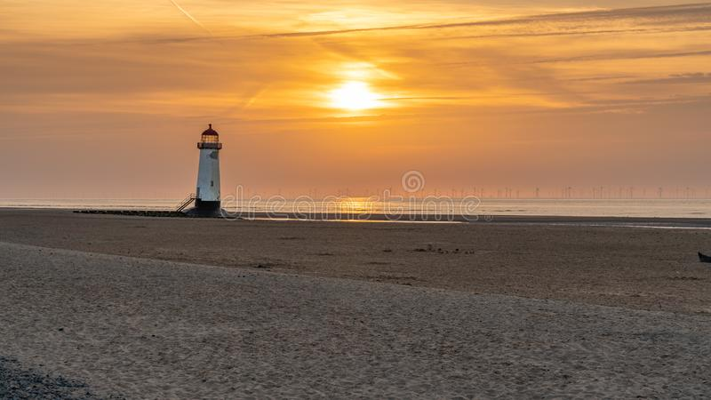 Talacre Lighthouse, Clwyd, Wales, UK. Sunset at the Point of Ayr Lighthouse near Talacre, Flintshire, Clwyd, Wales, UK royalty free stock image