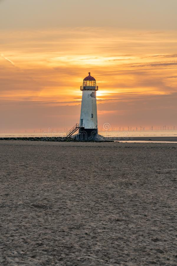 Talacre Lighthouse, Clwyd, Wales, UK. Sunset at the Point of Ayr Lighthouse near Talacre, Flintshire, Clwyd, Wales, UK royalty free stock images