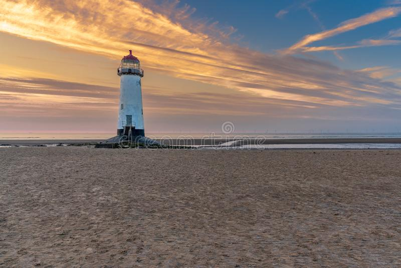 Talacre Lighthouse, Clwyd, Wales, UK. Sunset at the Point of Ayr Lighthouse near Talacre, Flintshire, Clwyd, Wales, UK royalty free stock photos