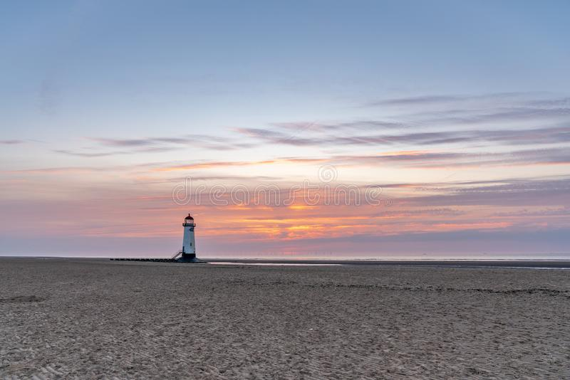 Talacre Lighthouse, Clwyd, Wales, UK. Sunset at the Point of Ayr Lighthouse near Talacre, Flintshire, Clwyd, Wales, UK royalty free stock photo