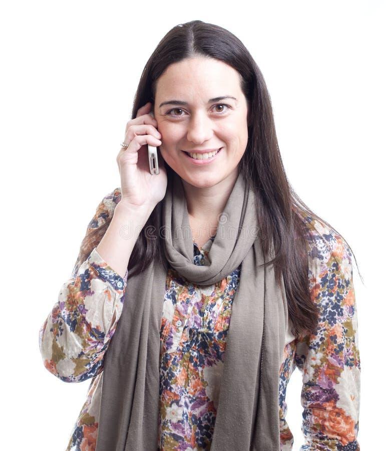 talande kvinna för härlig mobil telefon royaltyfria bilder