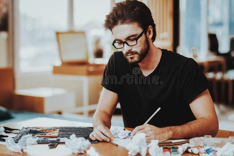 Talanted Freelance Male Artist Painting on Paper stock photos