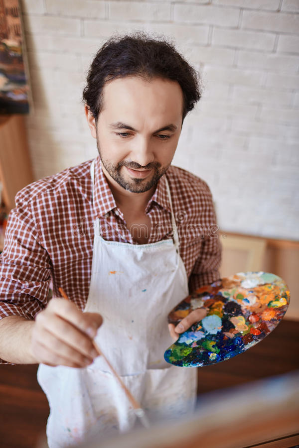 Talented Artist Enjoying Work in Art-Studio royalty free stock photos