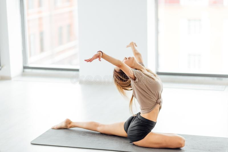 Talented dancer sitting on the semisplit and looking up royalty free stock images