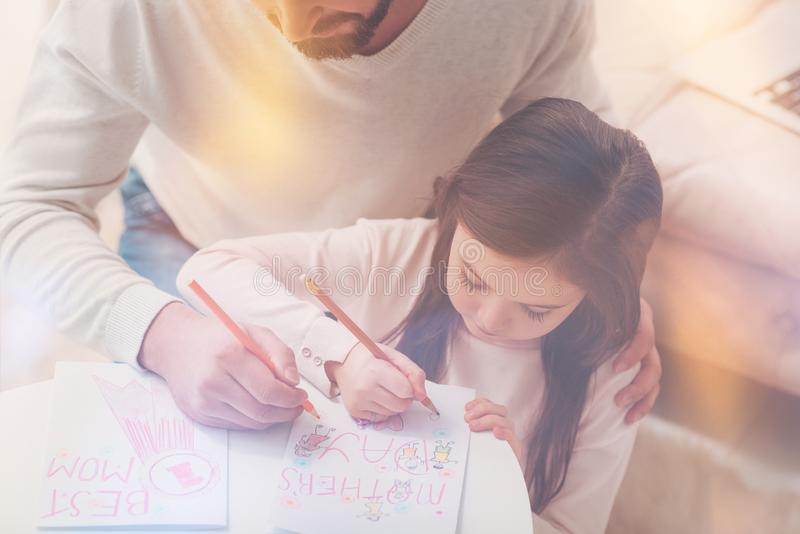 Talented dedicated child working on greeting card royalty free stock photos