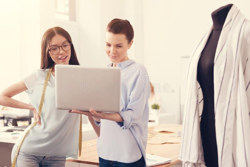 Talented designers using a laptop royalty free stock photo