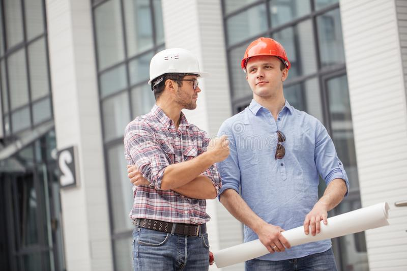Talented engineer is talking with experienced architect stock photos