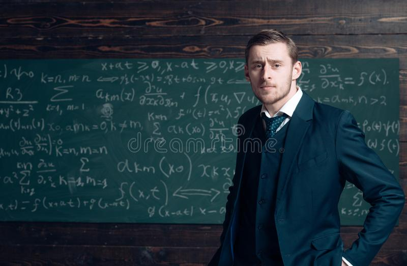 Talented mathematician. Teacher smart student intrested math physics exact sciences. Man formal wear classic suit looks stock images
