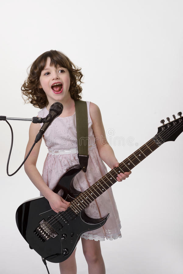 Talented musician plays the guitar stock image