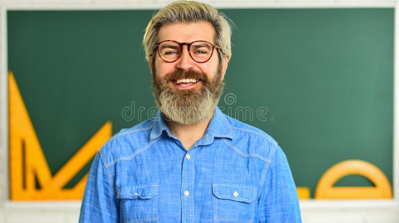 Talented pedagogue. Private lesson. Back to school. Man teacher mentoring school projects. Science modern school. Math. Subject. Study in college. Mature stock images
