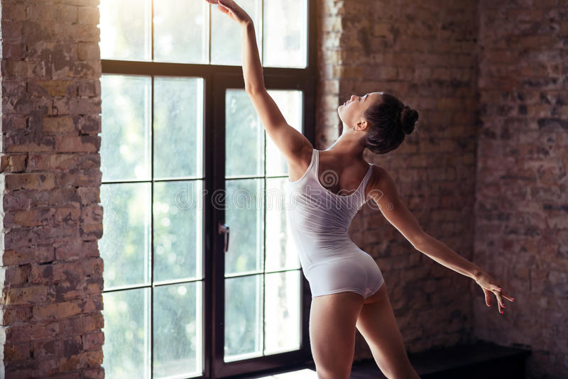 Talented slender woman dancing stock photos