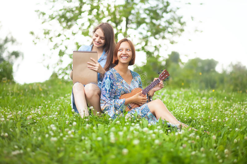 Talented students: painter and musician stock photography