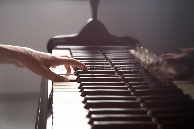 Talented woman playing piano royalty free stock photography