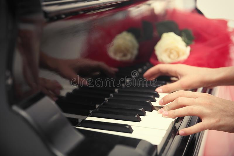 Talented woman playing piano stock images
