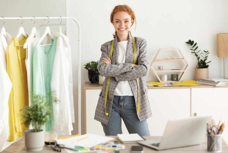 Talented young dressmaker posing in workshop, free space royalty free stock images